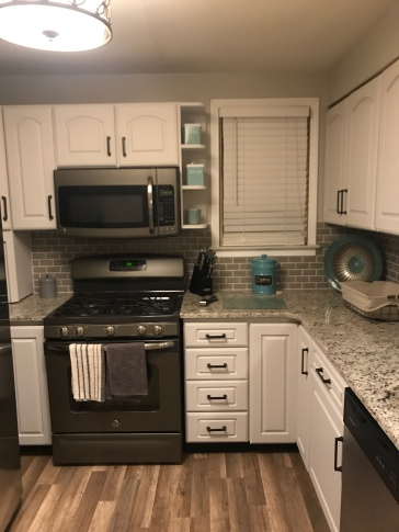 A backsplash was professionally added to also update the kitchen.